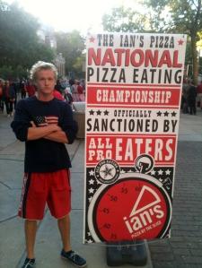 Sam Szotkowski participates in Ian's Pizza pizza eating contest.
